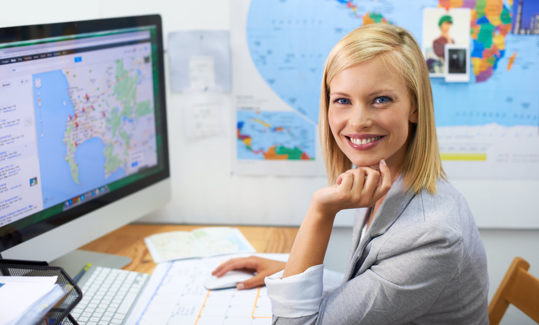 Woman sitting at desk surrounded by maps